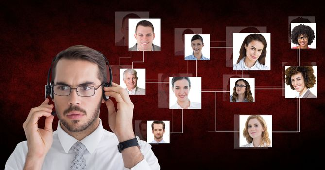 Serious businessman using headphones with candidates in background