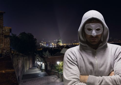 Anonymous Criminal in hood on street