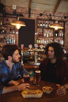 Friends having beer in pub