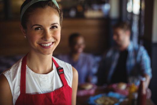 Smiling waitress at restaurant