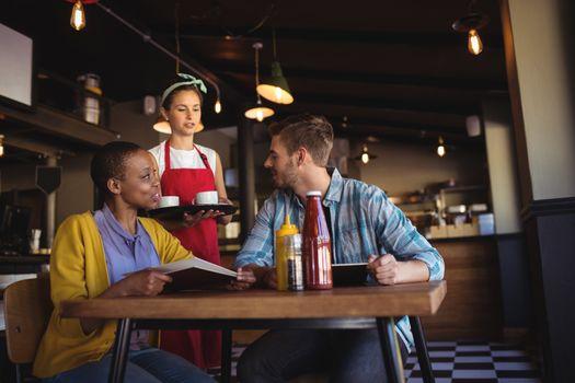 Waitress interacting with customer