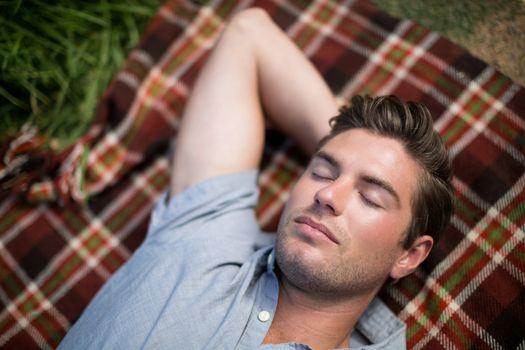 Man sleeping on blanket