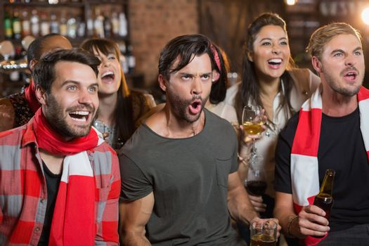 Cheerful friends shouting in pub