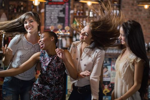 Carefree female friends dancing