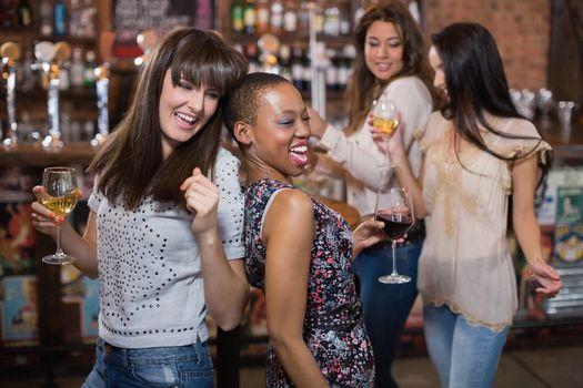 Female friends enjoying at pub