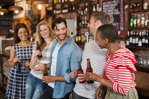 Cheerful friends enjoying at pub
