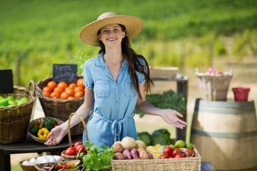 Portrait of smiling woman selling vegetables