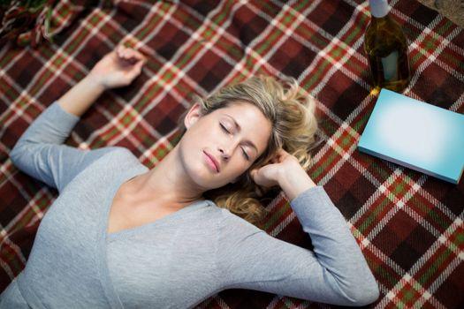 Woman sleeping on blanket