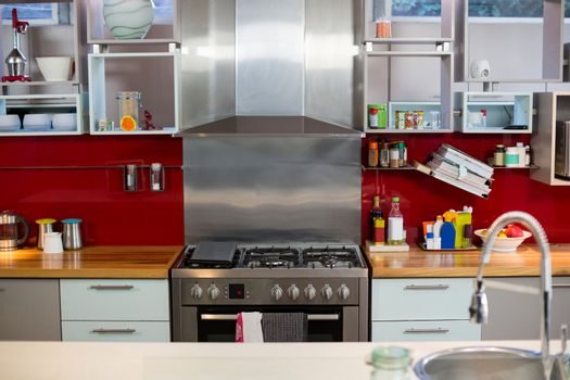 Stove and shelf in kitchen
