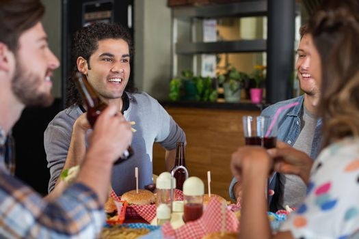 Friends drinking beer in pub