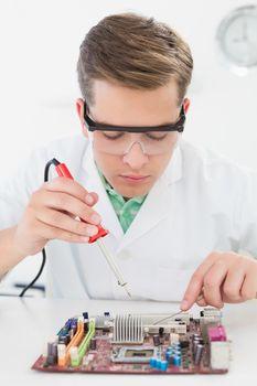 Technician working on broken cpu with soldering iron