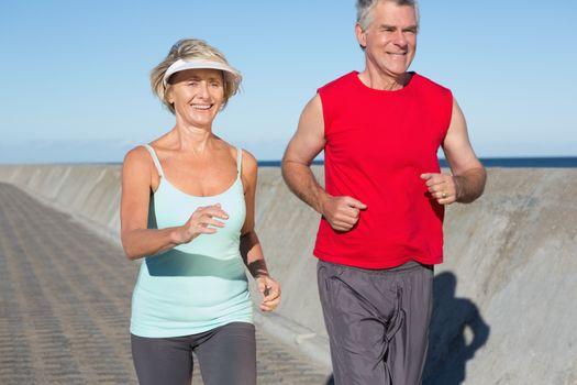Active senior couple out for a jog
