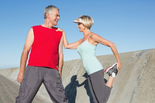 Active senior couple stretching before a jog