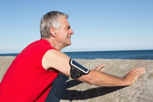 Active senior man stretching before a jog