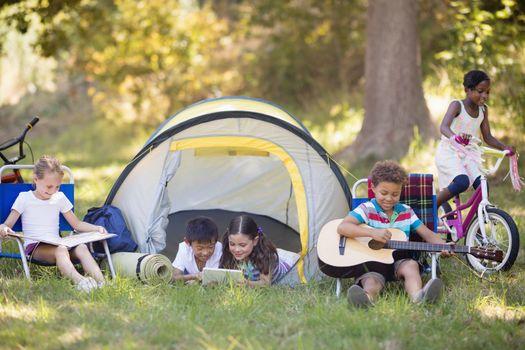 Children enjoying at campsite