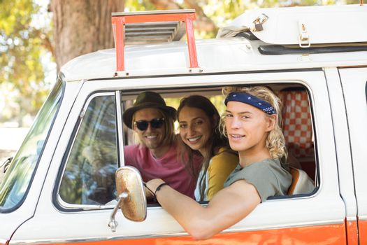 Portrait of friends in camper van