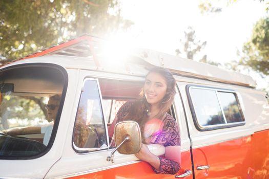 Woman leaning on camper van window