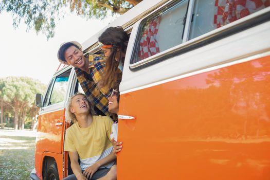 Smiling friends in camper van