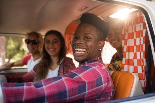 Cheerful friends in camper van