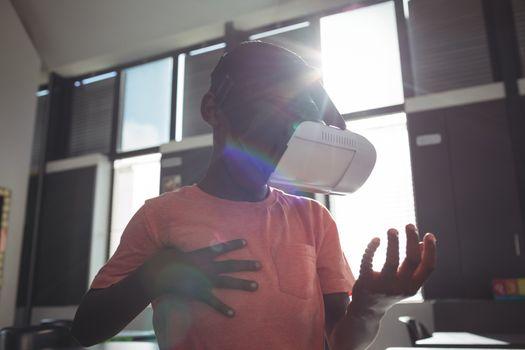 Boy wearing virtual reality simulator in classroom