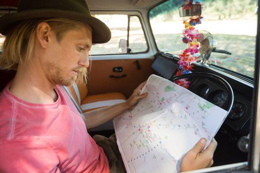 Man reading map in camper van
