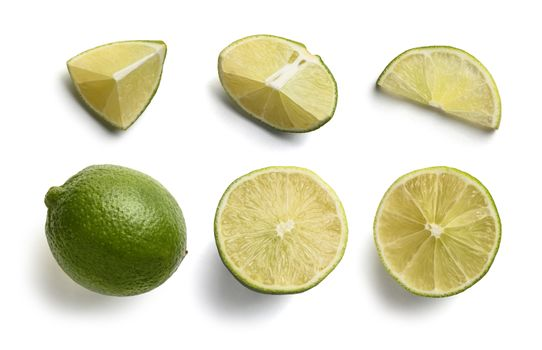 Set of lime slices on a white background. The view from the top.