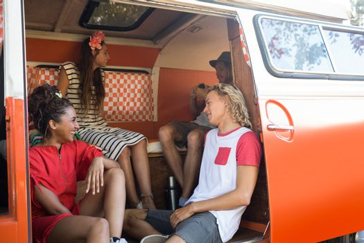 Happy young friends in camper van