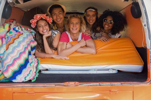 Portrait of smiling friends in camper van