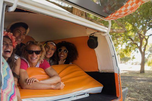 Happy friends in camper van