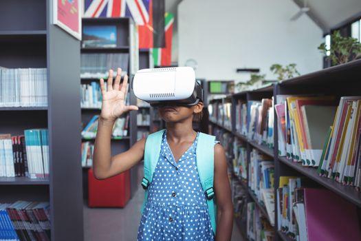 Girl gesturing while wearing virtual reality simulator