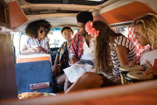 Young friends talking in camper van
