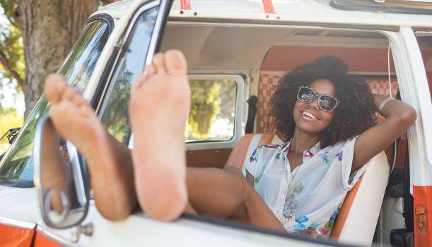 Smiling woman relaxing camper van