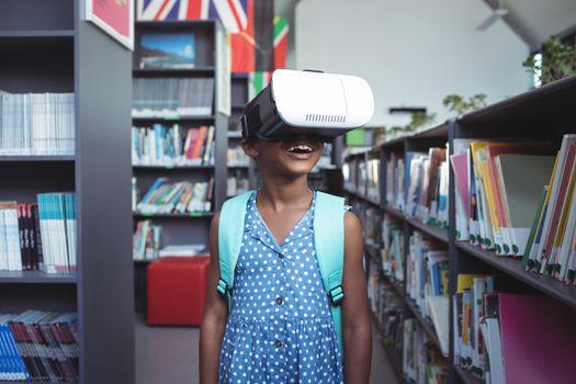 Girl wearing virtual reality simulator in library