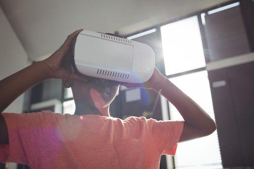 Close up of boy wearing virtual reality simulator