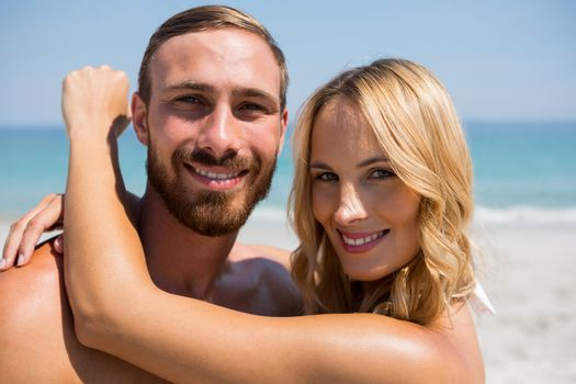 Close up of couple with arm around