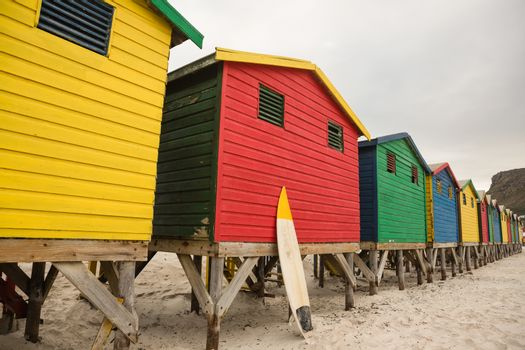 Multi colored wooden huts in row at beach