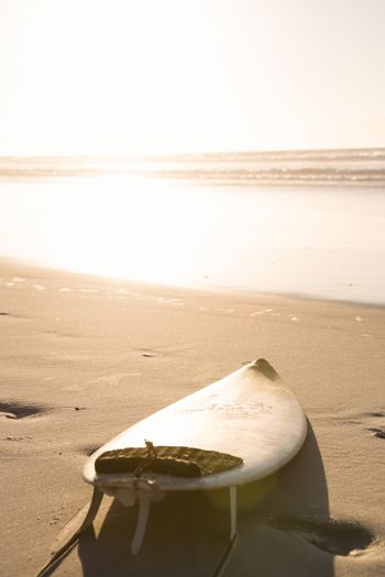 Surfboard at beach on shore