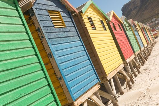 Close up of multi colored huts on sand