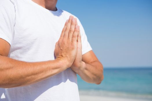 Midsection of man in prayer position