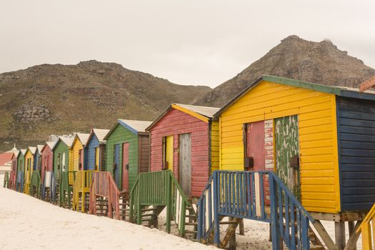 Multi colored wooden beach huts on sand