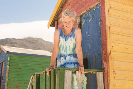 Portrait of woman standing at beach hut