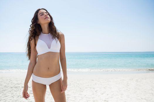 Seductive woman standing at beach