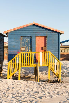 Multi colored beach hut on sand