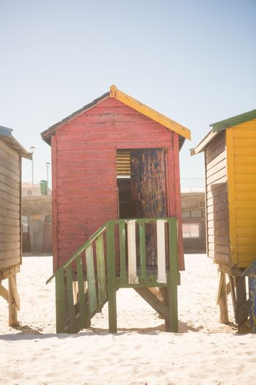 Beach huts on sand