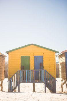 Yellow beach hut on sand