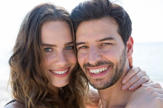 Portrait of smiling couple cheek to cheek