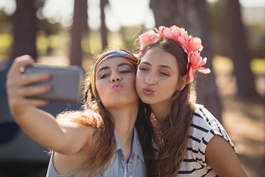 Close up of women puckering while clicking selfie