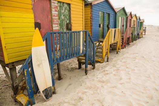 Surfboard by hut at beach