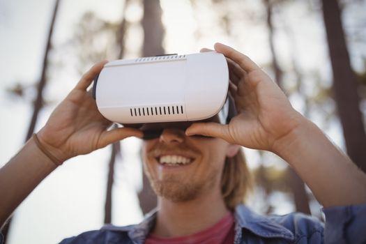 Young man wearing virtual reality simulator