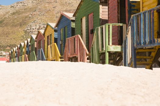 Close up of multi colored huts at beach